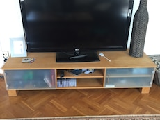 Wood Tv station with cupboards and shelves