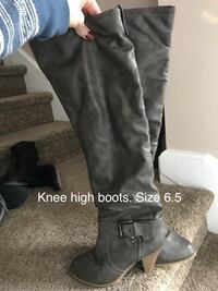 women's pair of gray leather knee-high boots