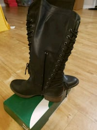 pair of black leather boots 27 mi