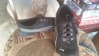 pair of black-and-white puma sneakers 2276 mi