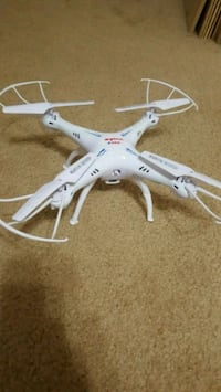 Syma X5C drone with additional batteries