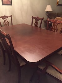 rectangular brown wooden table with six chairs dining set Mount Airy