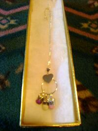 Silver necklace n charms Hedgesville