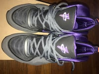 pair of gray-and-purple Nike basketball shoes Quincy, 02169
