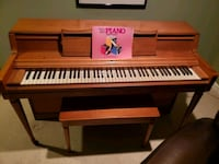 brown and black upright piano