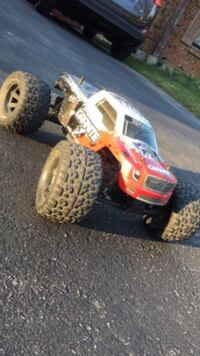 White, red, and black Grante RC truck