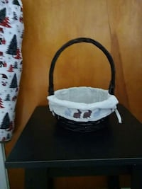 Brown basket with white liners with a row of rabbi Zanesville, 43701