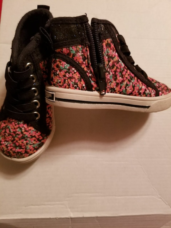 pair of red-and-black floral high-top sneakers