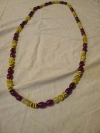 red and yellow beaded necklace New York, 10035