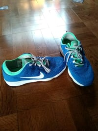 pair of blue-and-turquoise Nike Zoom running shoes Toronto, M5N 1P4