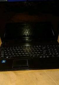 black laptop computer with AC adapter Faridabad, 121002