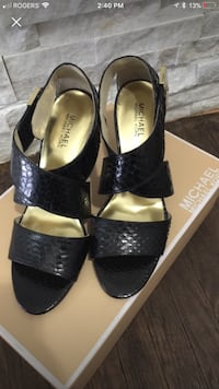 Pair of women's black michael kors leather peep-toe ankle-strap kitten heels with box