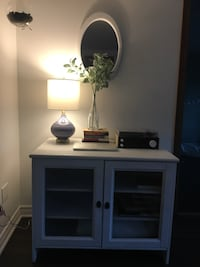 White media console with glass doors Laval