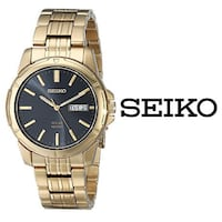 round gold-colored analog watch with link bracelet Toronto, M9W 7J4