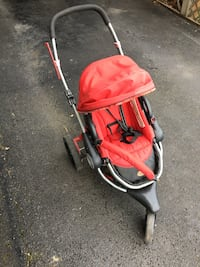 red and black jogging stroller Milton, 17847