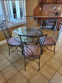 Round Glass Top Dinette with Five Chairs