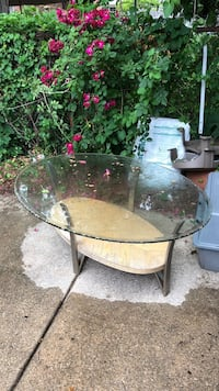Oval glass top table with gray metal base Ypsilanti, 48198