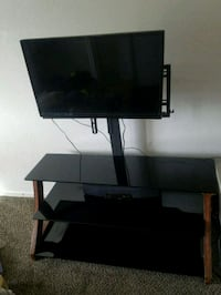 black wooden TV stand with a swiveling mount Riverbank, 95367