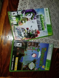 three assorted Xbox 360 game cases