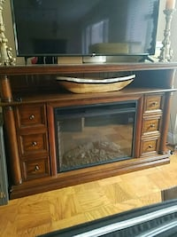 TV stand with built in fire place and heat option Arlington
