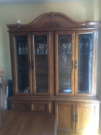 Brown wooden china cabinet.  Negotiable Sainte-Catherine, J5C 2B6
