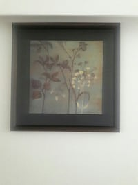 square brown wooden framed foliage painting