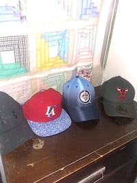three black, red, and blue fitted caps 1962 km
