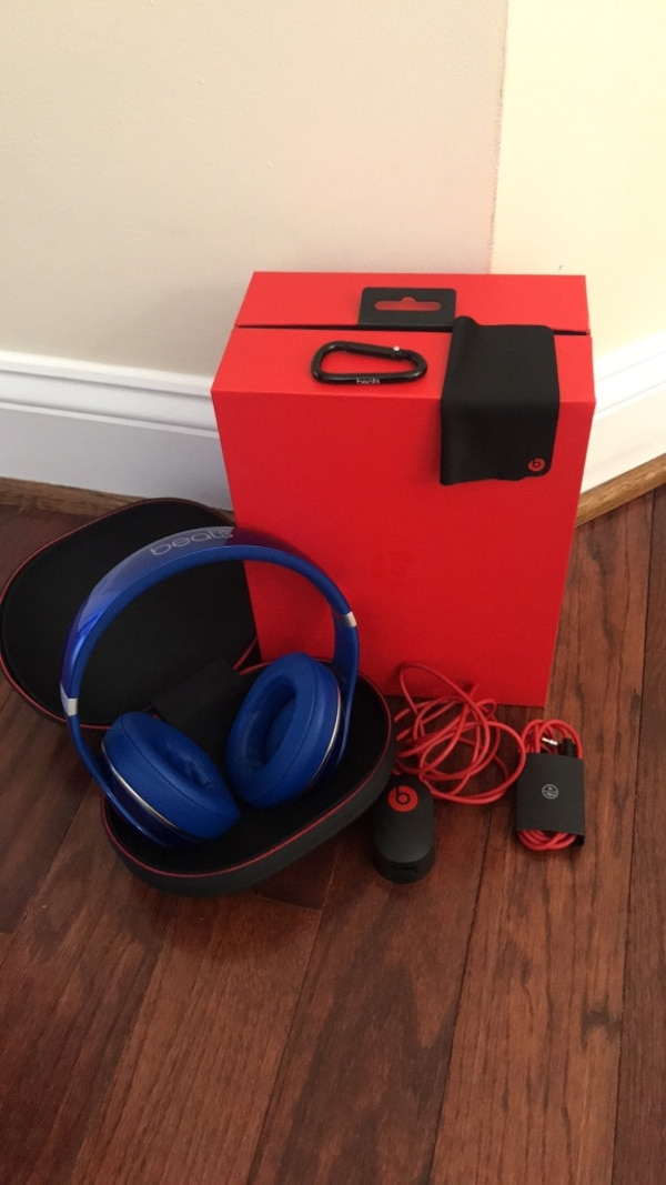 Blue and black corded headphones with box