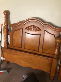 Brown wooden headboard and footboard and chest of drawers Hobson City, 36201