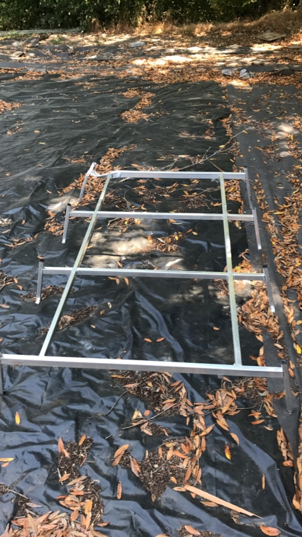 Aluminum truck rack with dent in left corner, weighs less then 10lb