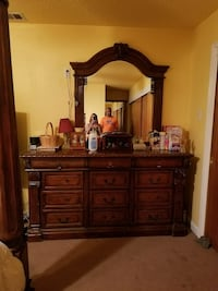 brown wooden dresser with mirror included.   Austin, 78754