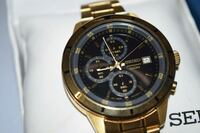 round gold-colored chronograph watch with link bracelet Kitchener, N2B 3R1