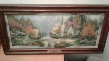 Brown wooden framed painting of house and trees