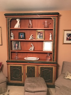 brown and black wooden display cabinet