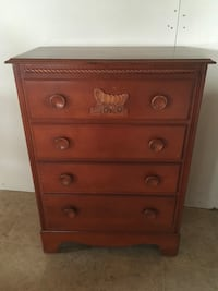 Chest of drawers with coach carving