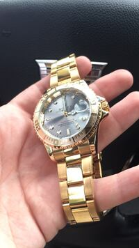 round gold Rolex analog watch with link bracelet Gaithersburg, 20878