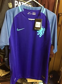 blue and white Nike Dri-Fit t-shirt