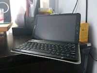 black tablet computer with keyboard case 64 km