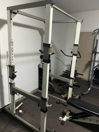 Squat rack with pull up bar attached