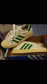 pair of white-and-green Adidas Superstar Buena, 08326