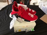 pair of red adidas low-top sneakers with box 490 mi