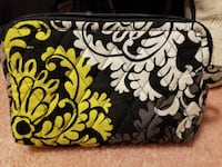 white, yellow, and black Vera Bradley wristlet