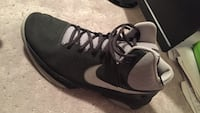 unpaired black and gray Nike basketball shoe