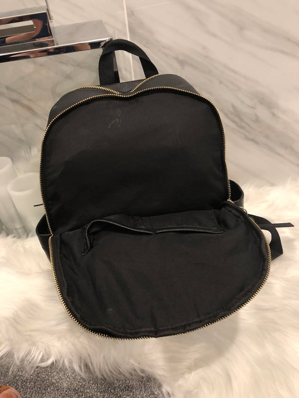 Madden girl black and gold leather backpack **OPEN TO OFFERS**. 7b43a4c3-ae96-4c82-90c4-e3a8a5d8d6a4