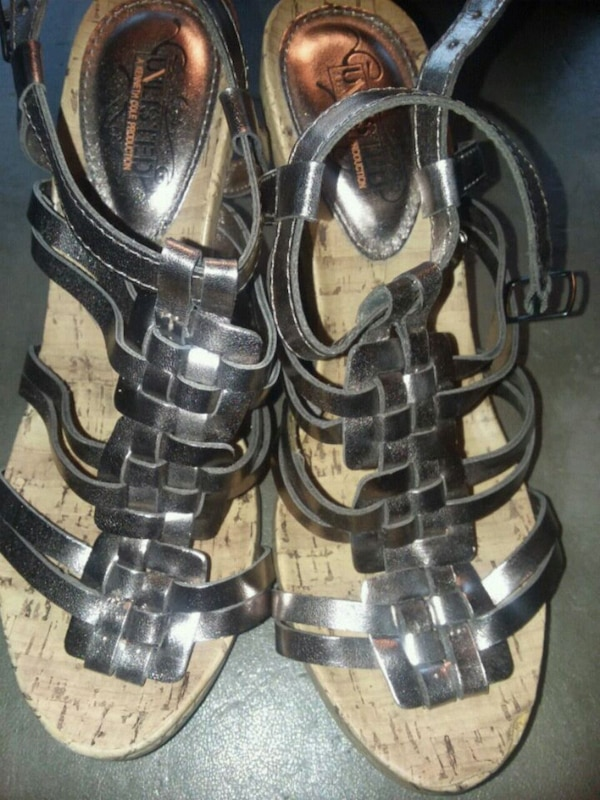 pair of black leather open toe ankle strap sandals