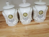 three white ceramic canisters with lid