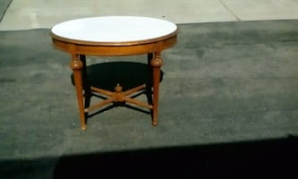 Oval shape table here wooden on the bottom and vin
