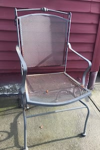 Cast iron table with 6 rocking chairs