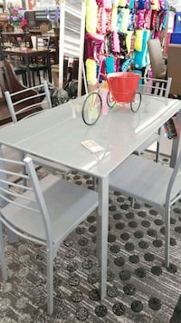 rectangular gray table with four chairs dining se Shreveport, 71107