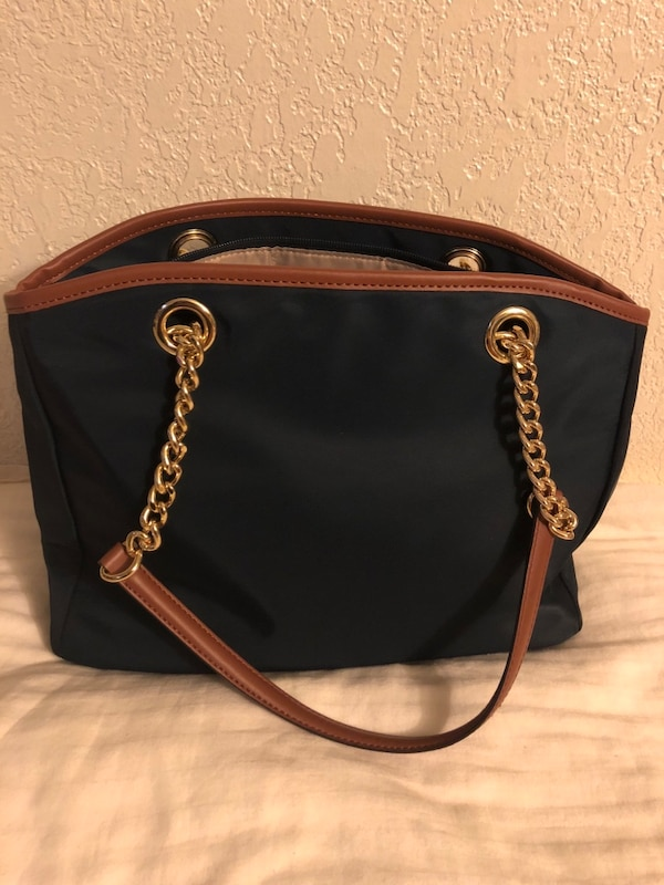 dea14417a68cb5 Used Black and brown michael kors leather tote bag for sale in Milpitas